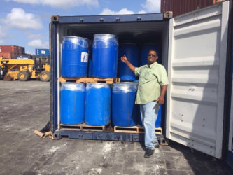 Mohan Jagnarine alongside his container of 'pepper mash' ready for shipping to Jamaica