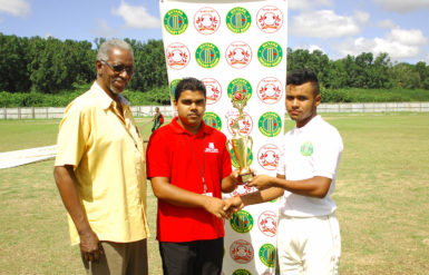 MVP! Ronald Renee collects his trophy from a representative of sponsors Hand-in-hand, with match referee Grantley Culbard a part of the presentation.