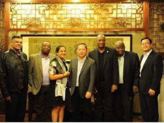 The photograph, which shows Tiwarie, APNU member Larry London, a representative of NICIL, Harmon and Williams in the company of two Chinese businessmen while on the China visit, yesterday began circulating on social media and was met with much criticism.