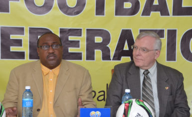 Canada's High Commissioner to Guyana Pierre Giroux, right and Golden Jaguars coach Jamaal Shabazz.