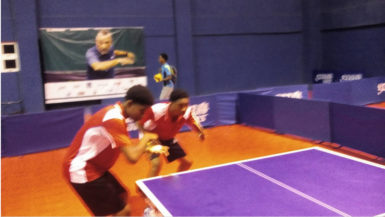 Guyana's 18 years and under Junior Boys doubles pair ofKyle Edghill and and Elishaba Johnson in the boys doubles final at the 21st2016 Caribbean Juniorand Cadet Table Tennis Championships being held in the Dominican Republic.
