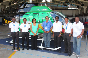 Telecommunications and Tourism Minister Cathy Hughes (third, left) poses with Maintenance Manager Tularam Ramsukh (centre) and the team of ASL engineers who worked on the rebranded aircraft.