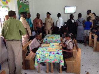 Students of La Parfaite Harmonie Primary School wasted no time in getting settled in their new library as parents and members of the Regional Office were given a tour of the room.