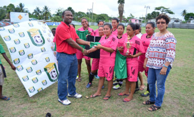 University of Guyana Challus McLennon handing over the Football Uniforms to Piaomak Warriors team in the presence of Minister within the Ministry of Indigenous Peoples Valerie Garrido-Lowe following the conclusion of the NAWF women's Championships yesterday. (Orlando Charles photo)