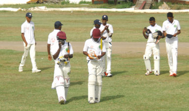 The U17 boys walking off after being dismissed for a 1st innings 243. (Orlando Charles photo)
