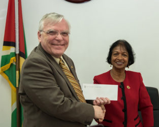 High Commissioner of Canada Pierre Giroux handing over the cheque to Chairperson of the W&GEC Indra Chandarpal