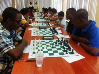 Action in the seven round ECI-sponsored Swiss-system chess tournament which took place at the National Resource Centre last weekend