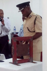Deputy Director of Prisons Gladwin Samuels demonstrating to the tribunal how the locks at the prisons operate.