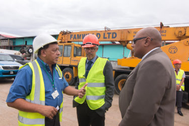 Muneshwers' Country Manager Robin Muneshwer (left), in talks with Minister of Natural Resources Raphael Trotman (right) and Minister of Business Dominic Gaskin yesterday.