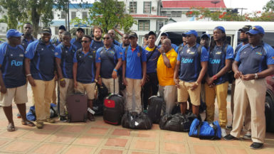 The Barbados national 15s rugby outfit pose for a photo before checking into the Sleep In Hotel yesterday afternoon.