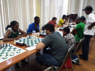 Student of St Stanislaus College Jessica Callender opposes Roberto Neto in the ECI's chess tournament last Sunday at the National Resource Centre. Callender is becoming a staple at the Guyana Chess Federation's competitions and has been steadily improving her expertise in the game. Former student of Saints, Ron Motilall, coaches chess at the college on Fridays after classes. (Photo by Ryan Singh)