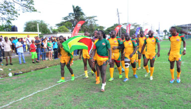 Winners! The national 15s men's rugby team marches with the Golden Arrowhead following their 48-17 victory over Barbados in the opening game of the 2016 Rugby America's North 15s championship yesterday at the National Park. (Orlando Charles photo)