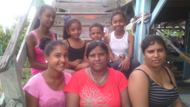 Villagers catching some fresh air on their stairs, from left, top: Devi, Rema, Wazir and Gomattie and bottom from left: Devina, Kamini and Naseema