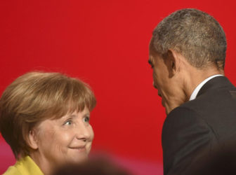 U.S. President Barack Obama speaks to German Chancellor Angela Merkel during the opening ceremony of the Hannover Messe in Hanover, Germany April 24, 2016. REUTERS/Nigel Treblin