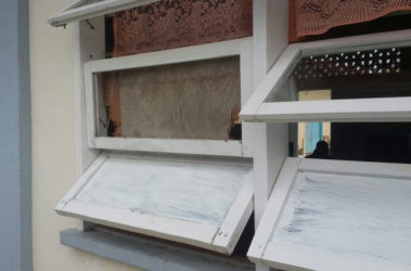 The window that the bandits broke to gain access to the building