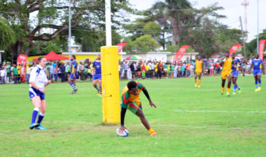 Lance Adonis breaches the try-line of the Bajans to help Guyana record a 48-17 victory over the visitors in the opening game of the 2016 Rugby America's North 15s championship Saturday at the National Park. (Orlando Charles photo)