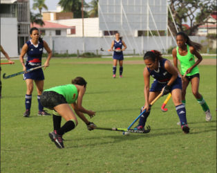 Kerensa Fernandes (blue) of GCC battling for possession of the ball with a Hikers player during their fixture in the inaugural Woodpecker Women's Hockey League at the GCC ground.