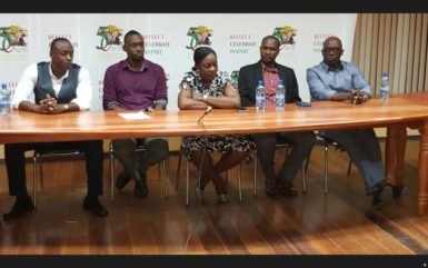 Minister within the Ministry of Education Nicolette Henry (centre) addressing the gathering at the forum while Alex Bunbury (left), NSC Director Christopher Jones (2nd left), GFF President (2nd right) and Sam Bunbury (right) looks on
