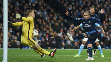 Manchester City's goalkeeper Joe Hart makes a point blank save from Real Madrid's Pepe.