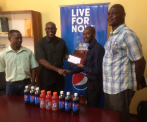 President of the GBA, Steve Ninvalle receives timely sponsorship from Larry Wills, Manager of the Pepsi brand yesterday ahead of the Caribbean's first Schoolboys and juniors tournament is staged here tomorrow and Saturday at the Cliff Anderson Sport Hall.