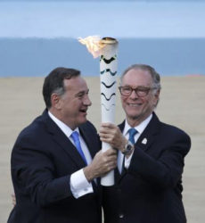 Spyros Capralos, head of the Hellenic Olympic Committee (L), hands over an Olympic torch to Rio's Olympic chief Carlos Nuzman during the handover ceremony of the Olympic Flame to the delegation of the 2016 Rio Olympics, at the Panathenaic Stadium in Athens, Greece, yesterday..REUTERS/ALKIS KONSTANTINIDIS