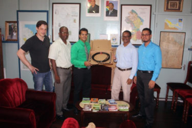 REETA's Representative  Ken Aldonza (2nd from right) handing over the equipment to GEA's CEO Dr. Mahender Sharma. Standing at extreme left is Tobias Dertman.