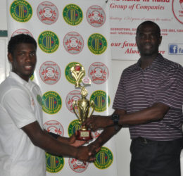 At Everest, Keemo Paul collects his Man-of-the-Match award from ex-Guyana and West Indies pacer, Match Referee Reon King.