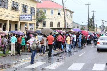 The long line of persons in front of the passport office yesterday.
