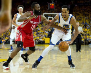 Golden State Warriors guard Shaun Livingston (34) controls the ball against Houston Rockets guard James Harden (13) during the third quarter in game five of the first round of the NBA Playoffs at Oracle Arena. Kelley L Cox-USA TODAY Sports