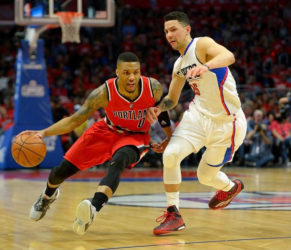Los Angeles Clippers guard Austin Rivers (25) guards Portland Trail Blazers guard Damian Lillard (0) in the first half of game five of the first round of the NBA Playoffs at Staples Center. Mandatory Credit: Jayne Kamin-Oncea-USA TODAY Sports