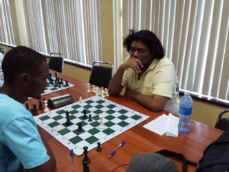 Taffin Khan (right) and Anthony Drayton, two of Guyana's finest chess players, clashed in the recent ECI classical seven round chess competition. Drayton earned the title of FIDE Candidate Master at the Tromso, Norway, Chess Olympiad in 2014. It is therefore interesting for players to view the games of the two and witness some tested moves of pre-eminent grandmasters.