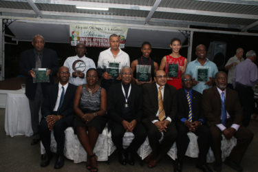 President David Granger, (seated third from left) along with the recipients of the awards along with the top brass of the GOA pose for a photo following the Appreciation and Award Ceremony at the Georgetown Club on Friday evening.