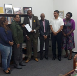 Prime Minister Moses Nagamootoo receives the final report from Convenor Nigel Hughes in the presence of from left: Geeta Chandan-Edmond, Professor Duke Pollard, Gino Persaud and Tamara Khan. Chandan-Edmond and Persaud are members of the Steering Committee while the others would have provided support.