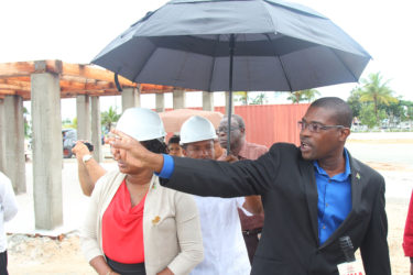 Junior Public Infrastructure Minister Annette Ferguson (left) and Minister David Patterson showing media personnel around the site