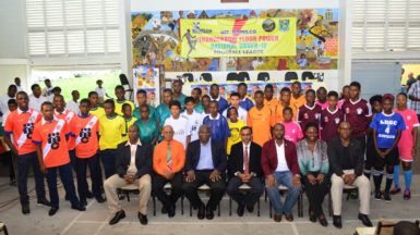 Members of NAMILCO including Financial Consultant Fitzroy McLeod (third from left) and the GFF executive committee including President Wayne Forde (third from right) pose with members of the participating clubs following the launch of the Thunderbolt Flour Power National Under-17 Intra-Association Football League last week. (Orlando Charles photo)