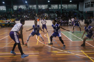 Action between Marian Academy and President's College in the u-16 division of the NSBF Georgetown and East Coast Regionals at the Cliff Anderson Sports Hall Sunday.