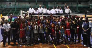 The boxers along with their trainers and officials of the Caribbean's Schoolboys and Juniors tournament pose for a photo opportunity after the two-night tournament concluded at the Cliff Anderson Sports Hall on Saturday night.