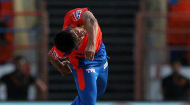 Shivil Kaushik in action in the IPL.