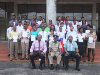 The thirty-seven ranks posed with Crime Chief Wendell Blanhum (sitting in front row, at left), Force Training officer Paul Williams and Course Coordinator Brian Eastman at the conclusion of the closing ceremony on Friday.