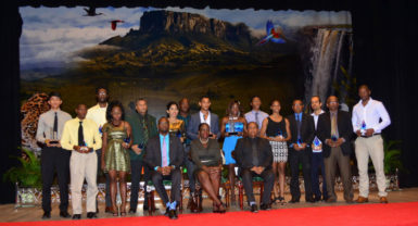 Last night's awardees pose for a photo opportunity with Director of Sports, Chris Jones and Minister within the Ministry of Education, Department of Culture and Sport, Nicolette Henry at the conclusion of the National Sports Commission annual award ceremony.(Orlando Charles photo)