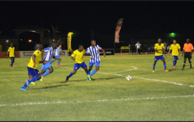Curtis Kellman (left) of GFC trying to fight off the challenge of Pele's Jamal Cozier (2nd from left) at the Leonora Sports Facility in the GFF Stag Beer Elite League