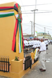 President David Granger about to lay a wreath yesterday at the restored cenotaph in the centre of Bartica, which was officially declared a town. (Photo by Keno George)