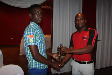Tournament MVP Stanton Rose (left) collecting his accolade from Mackeson Brand Manager Jamaal Douglas during the presentation ceremony