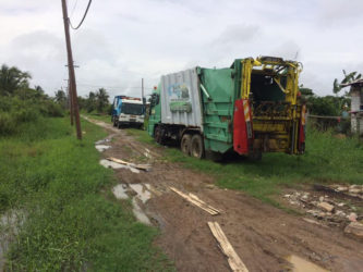The two garbage trucks parked up in 'E' Field Sophia