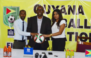 GFF Vice-President Rawlston Adams (centre) posing with DDL Brand Manager Larry Wills (left) and Ansa McAl PRO Darshannie Yussuf following the conclusion of the press conference declaring the two entities commitment to the international friendly against Canada's Olympic Team.