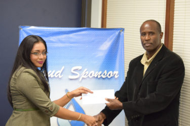GFF Vice-President Bruce Lovell (right) collecting the sponsorship cheque from GBTI Public Relations and Marketing Manager Pamela Binda.
