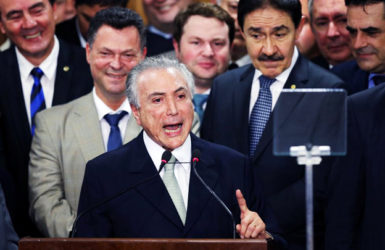 Brazil's interim President Michel Temer addresses the audience during his first public remarks after the Brazilian Senate voted to impeach President Dilma Rousseff at the Planalto Palace in Brasilia, Brazil, May 12, 2016. REUTERS/Adriano Machado
