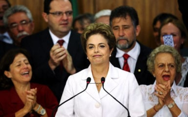Supporters applaud as suspended Brazilian President Dilma Rousseff (C) addresses the audience after the Brazilian Senate voted to impeach her for breaking budget laws, at Planalto Palace in Brasilia, Brazil, May 12, 2016. REUTERS/Adriano Machado