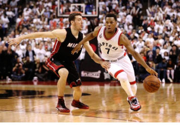 Toronto Raptors point guard Kyle Lowry (7) drives to the basket past Miami Heat point guard Goran Dragic (7) in game five of the second round of the NBA Playoffs at Air Canada Centre. The Raptors beat the Heat 99-91. Tom Szczerbowski-USA TODAY Sports
