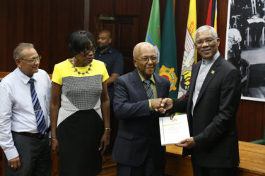 Chairman of the Commission of Inquiry (CoI) into the Public Service Harold Lutchman (second from right) presents the CoI's report to President David Granger as commissioners Sandra Jones (second from left) and Samuel Goolsarran look on.  (Photo by Keno George)